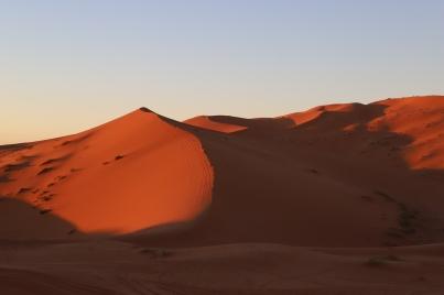 Sahara Tour - letzte Sonnenstrahlen am Abend in den Dünen von Erg Chebbi